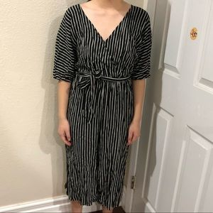 Black and white striped jumpsuit.